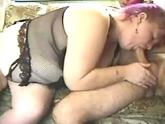 Old fat lady sucking cock on sofa